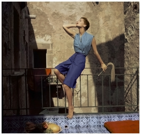model-resting-on-railing-wearing-blue-knee-length-culottes-with-brass-buttons-and-sea-green-high-throated-shirt-circa-january-1955-palermo-sicily-photo-henry-clarke