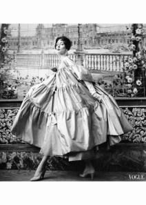 Suzy Parker wears a voluminous bow tied coat by Pertegaz for Vogue March 1954