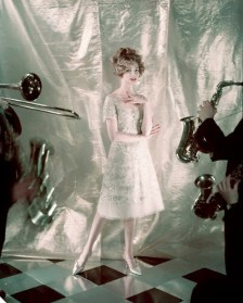 ca. 1958 --- Model standing in front of lame backdrop, wearing tulle and gold embroidered trapeze dress form Dior. --- Image by © Condé Nast Archive/CORBIS