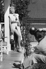 Rita Hayworth being photographed by Ed Cronenweth at her home in Santa Monica in 1947
