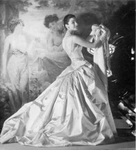 dorian-leigh-with-artwork-wearing-a-taffeta-gown-by-jean-patou-1955-photo-by-henry-clarke
