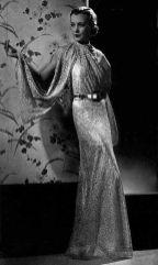 maggy-rouff-robe-de-soiree-dentelle-rose-metallisee-et-ceinture-argent-images-de-mode-1936