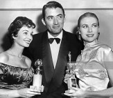 us-actor-gregory-peck-is-surrounded-23-february-1956-by-grace-kelly