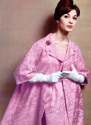 Model wearing a dress and a coat by Jacques Heim 1960