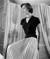 Model wearing a pleated gold skirt, photo by Nina Leen, 1950
