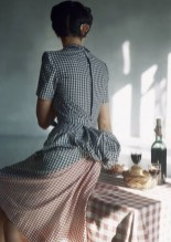 Model in bustle-backed dress in two shades of gingham check by Adrian,Vogue, 1944
