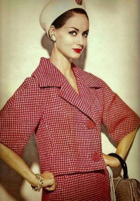 Katherine Pastrie in red and white checked tweed suit by Monte Sano and Pruzan, pillbox by Halston, handbag by Gucci, photo by Leombruno-Bodi, Vogue, January 1960