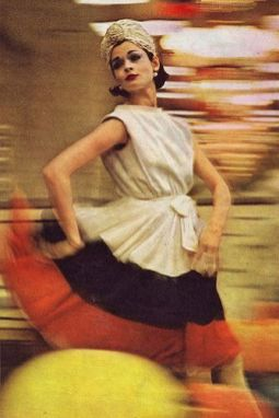 Model in street-length white chiffon dress bordered in navy and red by Galanos, photo by Gordon Parks, 1961