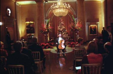 """Airdate: Wednesday, December 13 on NBC (9-10 p.m. ET) THE WEST WING -- NBC Series -- """"Noel"""" -- Pictured: (center) Yo-Yo Ma as himself -- LEGENDARY CELLIST YO-YO MA GRACES THE WEST WING IN WHITE HOUSE CHRISTMAS RECITAL -- Warner Bros. Photo"""