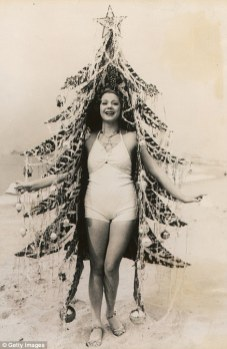 A beauty queen dressed as a Christmas tree 1930s