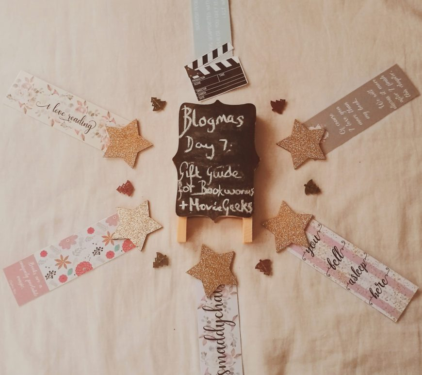 bookmarks, a tiny movie clapperboard and a chalkboard which says blogmas day 6: gift guide for bookworms and movie geeks