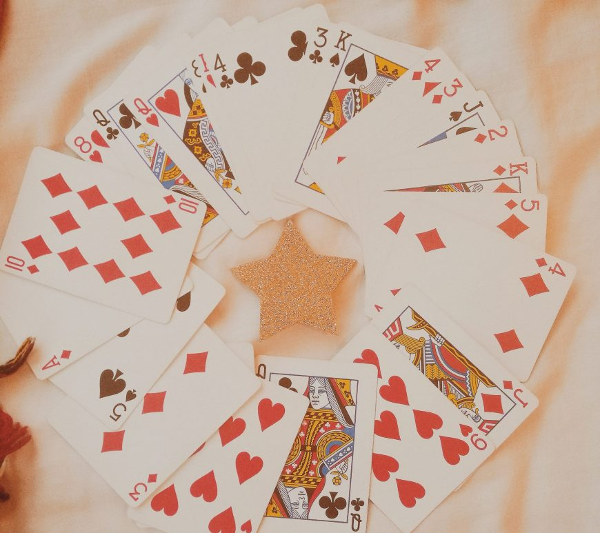 favourite games to play this festive season blog post featuring a deck of cards fanned out