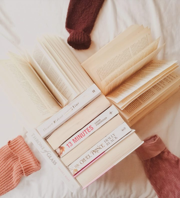 a lot of books formed in a heart with some sweaters for the post social media: behind the screens