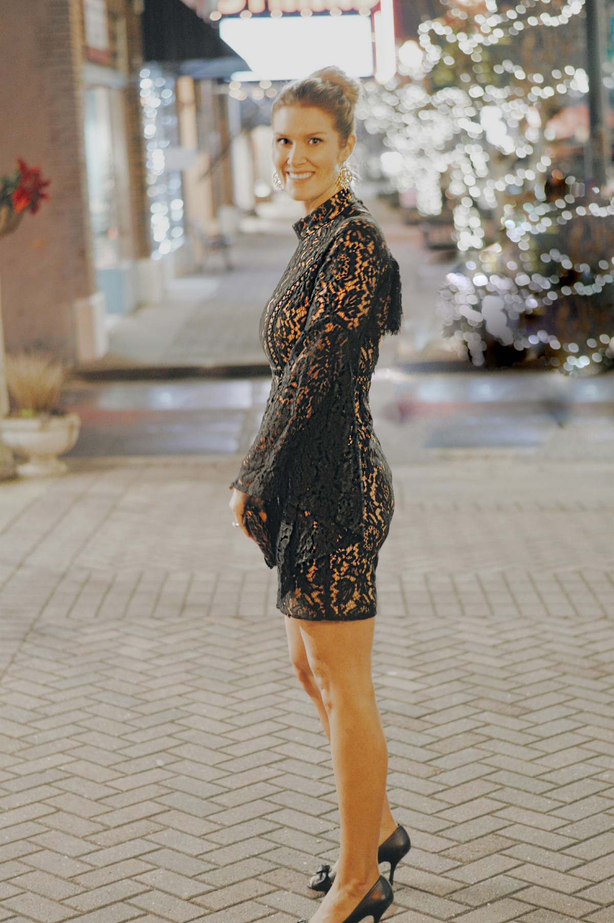 blogger in new years black dress