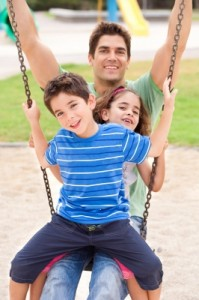 dad swinging with kids