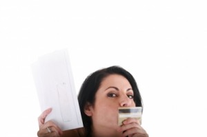 woman kissing credit card