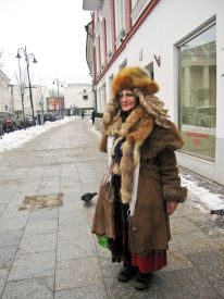 woman on the street dressed in extravagant clothing
