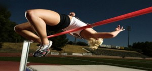 woman jumping over a rail