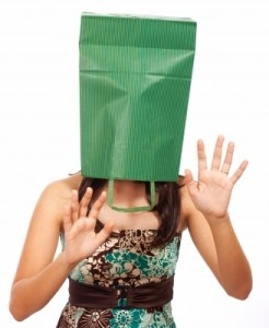 """Girl With Bag On Head Hiding"" by Stuart Miles"
