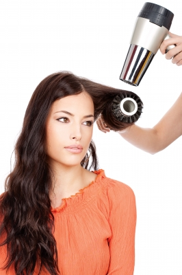 woman getting her hair blow dryed