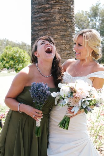 bride making her bridesmaid laugh on the wedding day
