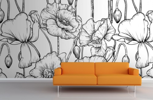 an orange couch against a black and white floral wallpaper