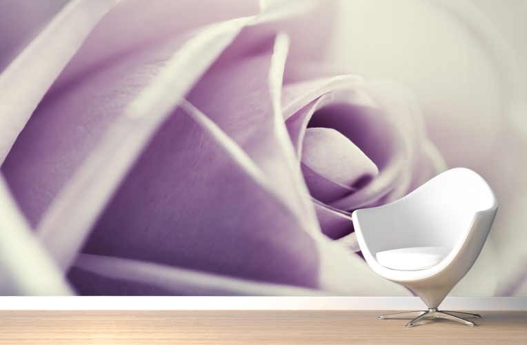 A purple rose mural behind a white chair.