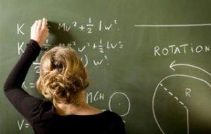 women doing math problems to earn math degrees