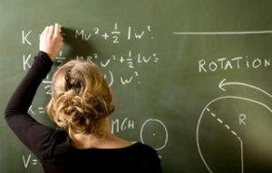 women doing math problems to earn math degrees