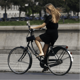healthy woman riding a bike