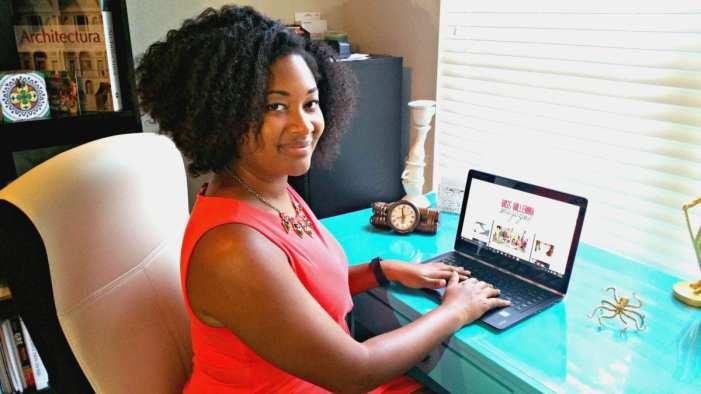 Jasmine Watts working on her blog Miss Millennia Magazine