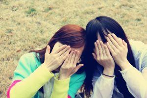 girls covering their eyes