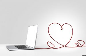 Laptop computer with cable forming a heart depicting online dating