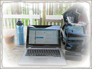 computer water bottle and starbucks on desk