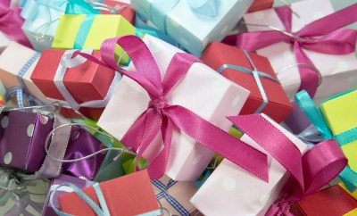 gifts with different colored wrapping and bows