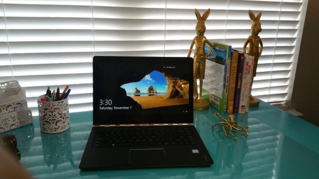 A Lenovo Yoga 2in1 laptop sitting on a desk