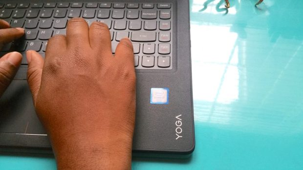 hands typing on a Lenovo yoga Intel 2in1