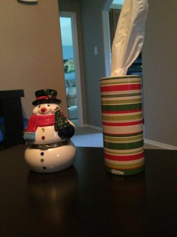 snowman and kleenex on table ready for holiday guests