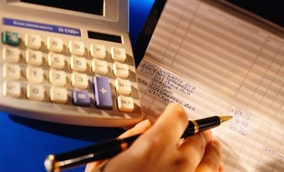 checkbook and calculator to manage personal finances