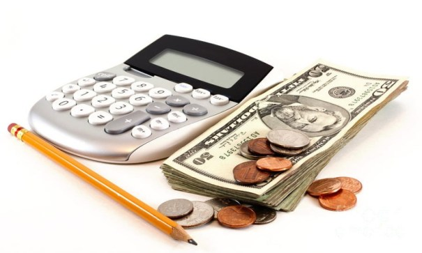 calculator and money and pencil to manage personal finances