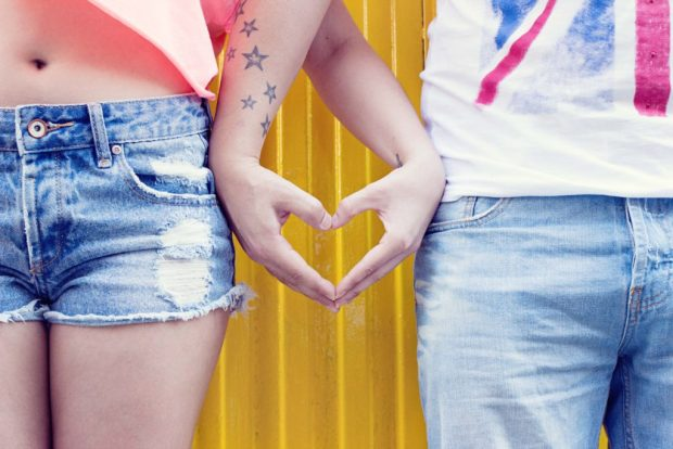 couple with tattoos showing engagement ring alternatives