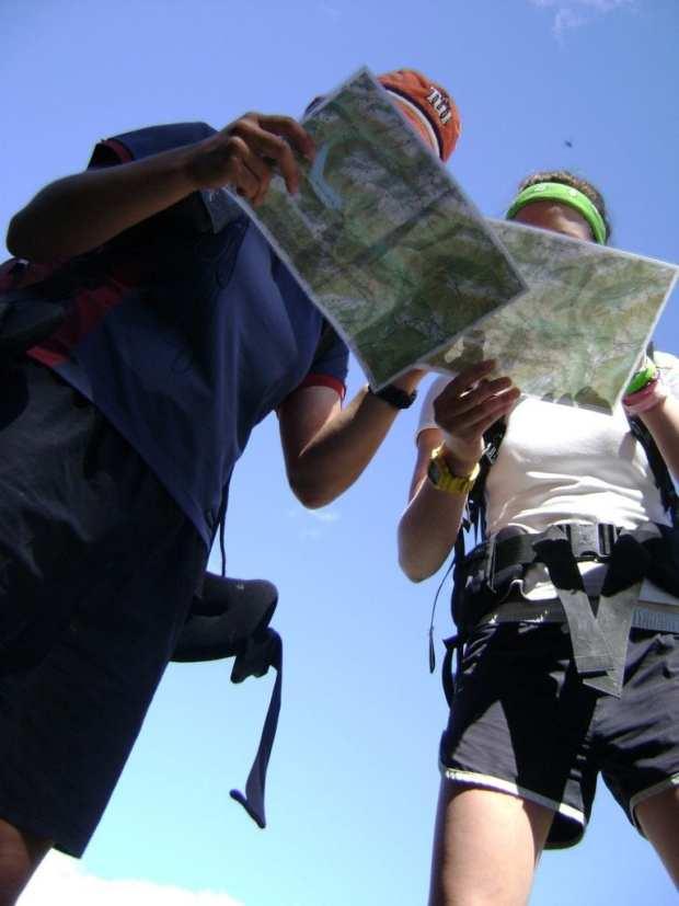Two women reading maps