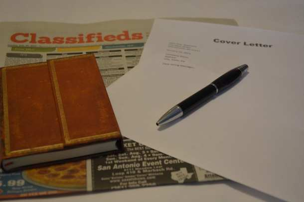 pen paper and notebook on newspaper