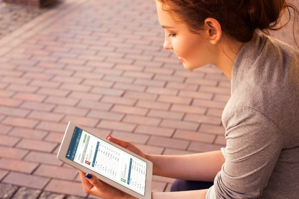 woman looking at iPad lexington law