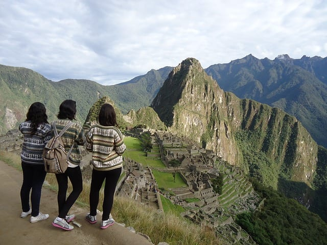 three girls standing at Macchu Picchu