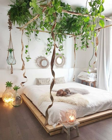 Bohemian bedroom - A romantic bed made with recycled pallets and canopy made from artificial plants