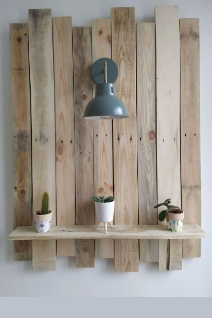 Farmhouse wall plant shelf made with recycled wood pallets
