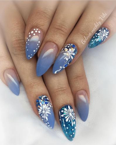 Gorgeous winter blue nails design with white snowflake