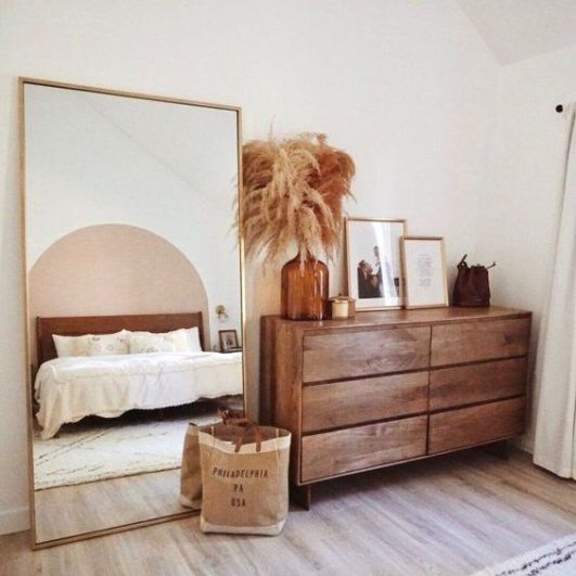 If you choose a beige bedroom decor in 2021 pampas grass is a must have along with a brown glass vase