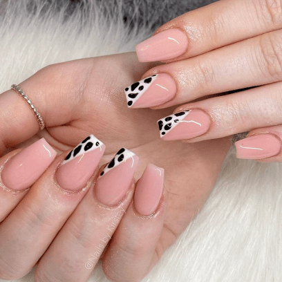 Medium length black and white leopard gel nails design